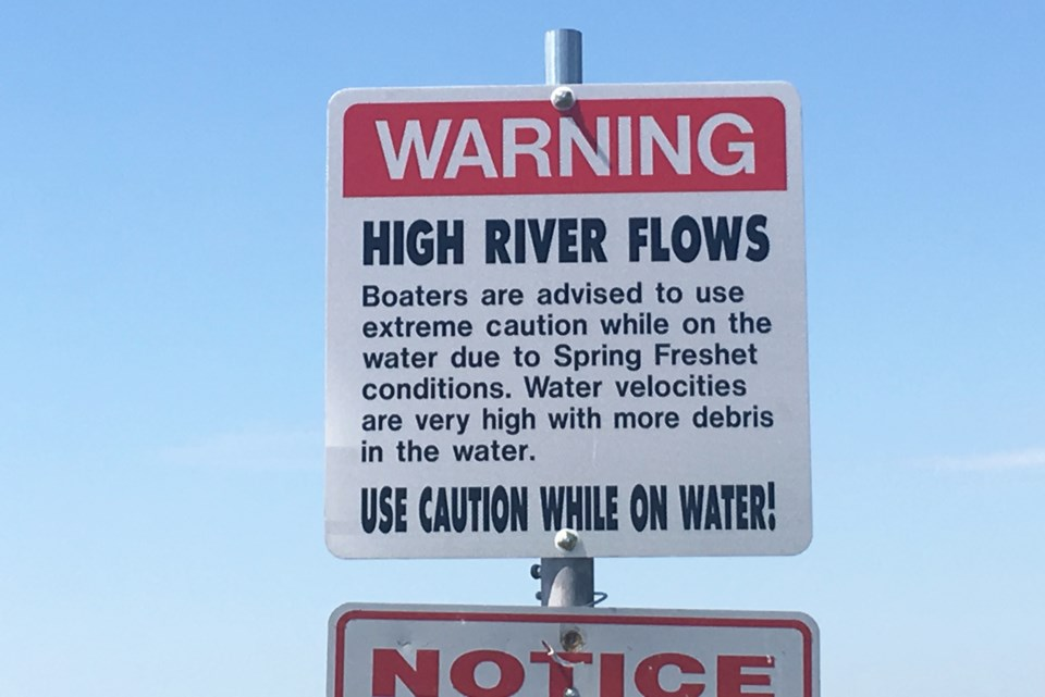 delta flood warning sign