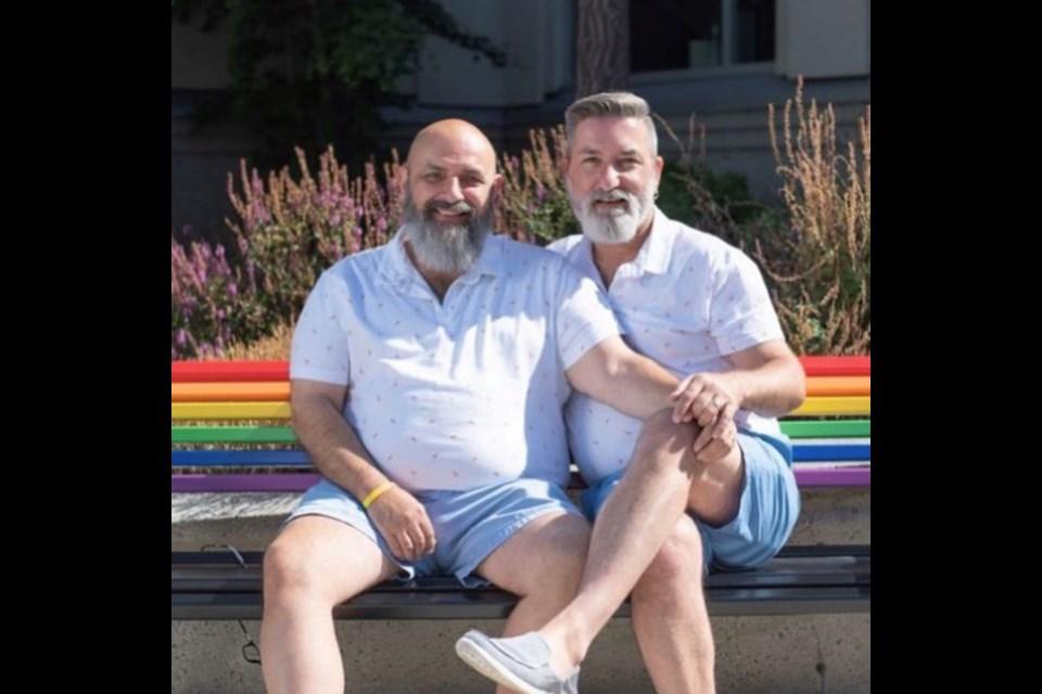 Delta Pride Society President John Darras (he/him) left, with husband Sandy Drover