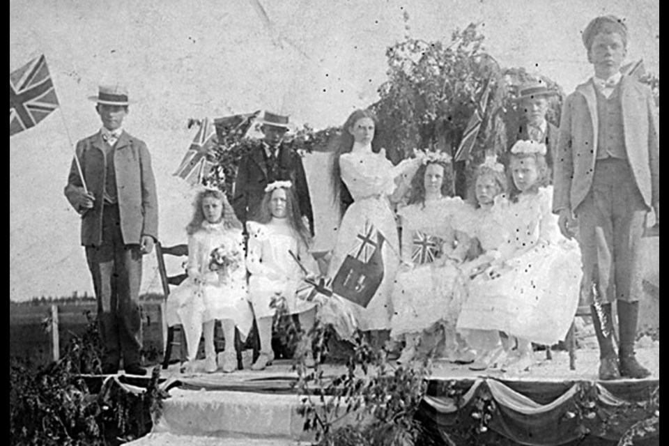 Here's the May Day celebrations of 1900 showing the May Queen of 1899, Mabel Thirkle, placing a crown of flowers on the May Queen elected for 1900, Alice Ladner.