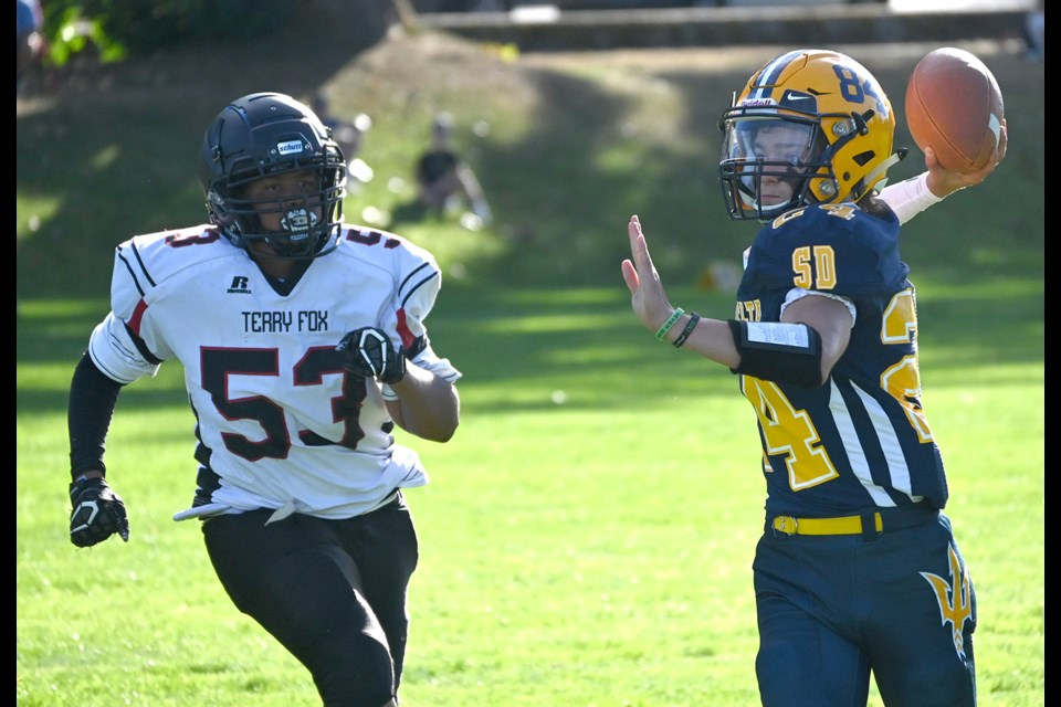 South Delta Sun Devils quarterback Dominic Dumas looks down field during his team's 8-7 win over the Terry Fox Ravens last week. It was the first competitive high school game in Delta in 18 months.