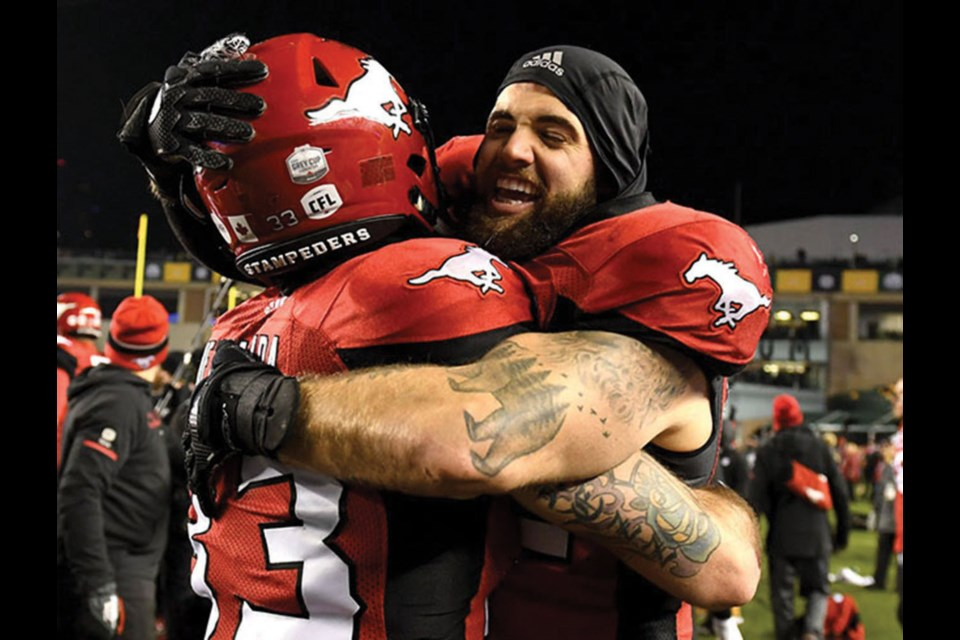 Tsawwassen Riley Jones celebrating Calgary Stampeders' Grey Cup win in 2018. The linebacker announced his retirement on Monday.