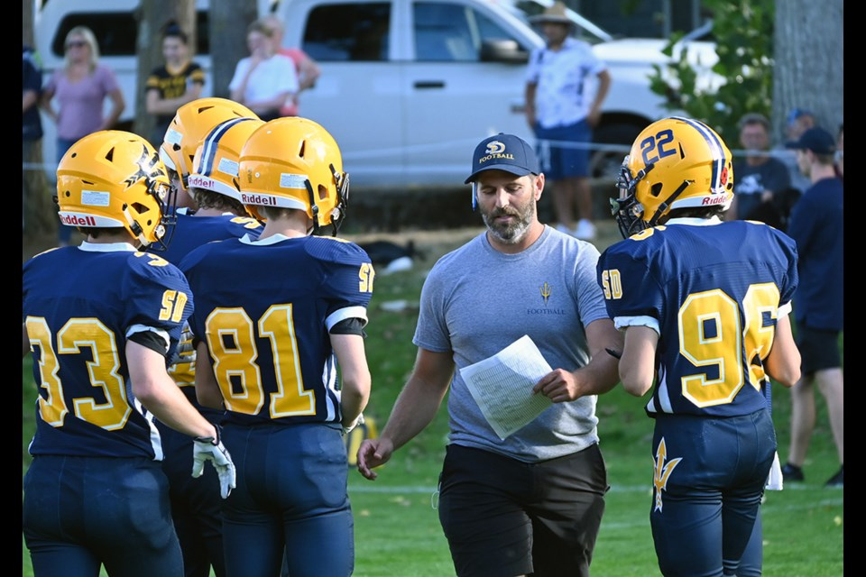 South Delta Secondary PE teacher and junior varsity football coach Scott Martens talking to his players during a timeout in last Thursday's season-opening win.