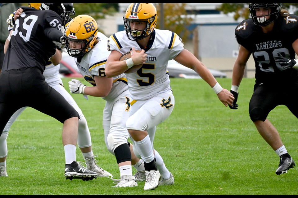 Jesse Mitran takes advantage of the running lane opened by Jaxen Moore on his way to a 176 yards rushing in South Delta's 34-13 season-opening victory over South Kamloops last Saturday at Dennison Park