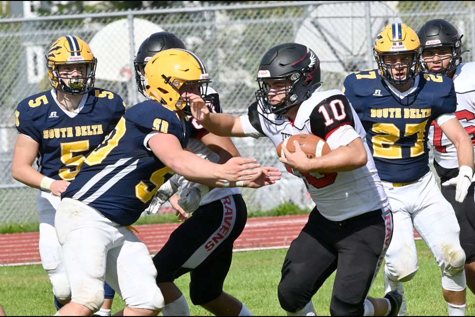 South Delta's Jack Morgenthaler closes in on Terry Fox Ravens' running back Alex Gagnon during Saturday's 21-7 loss in Tsawwassen.