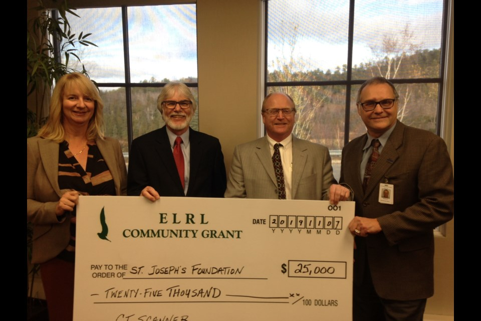 Elliot Lake Retirement Living donated $25,000 toward the planned $1.6 million CT Scanner for St. Joseph's General Hospital. Making the donation, from left, was Retirement Living GM Rhona Guertin and chairman Gil Contant to Hospital Foundation chairman William Elliott and hospital CEO Pierre Ozolins. Photo by Kris Svela for ElliotLakeToday
