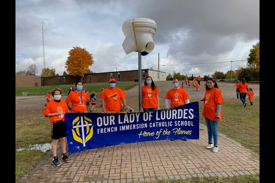 OLOL students and staff celebrated Orange Shirt Day including Lukas Schell (Grade 8), NSL Teacher Marlene Essex, Lee Simpson-Johnston, Vice Principal Nadia Zanatta, Principal Stephane Prevost and Madelyn Meawasige (Grade 7). Photo supplied