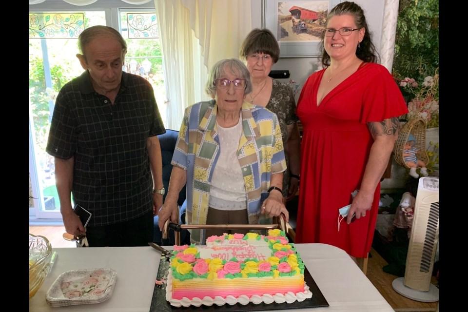 Celebrating her 100th birthday, Irene Stoliker is joined by her son Brian Douglas Stoliker, her daughter Anne Marie Fuglsang and granddaughter Jennifer Elizabeth Stoliker.