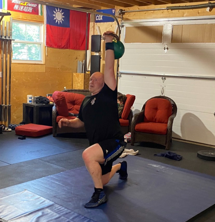 Local volunteer firefighter sets fitness world record for Turkish get-ups