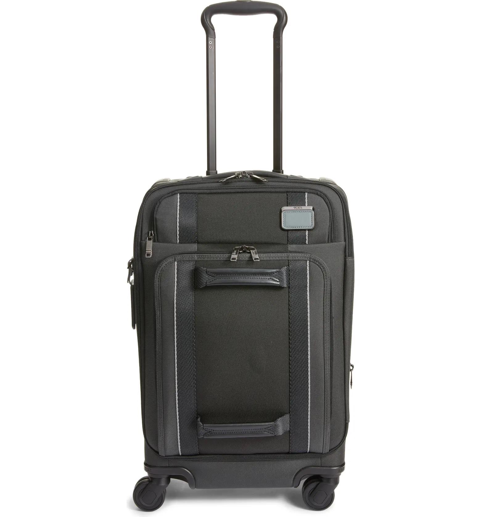 Tumi carryon luggage.