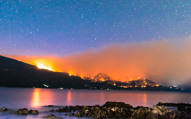 The White Rock Lake fire burning above Westside Road on the evening of Aug. 7.