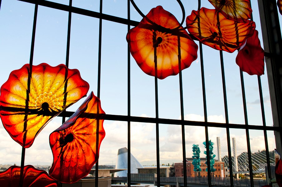 Looking through a glass art installation at Union Station, visitors can see Museum of Glass and Chihuly Bridge of Glass.