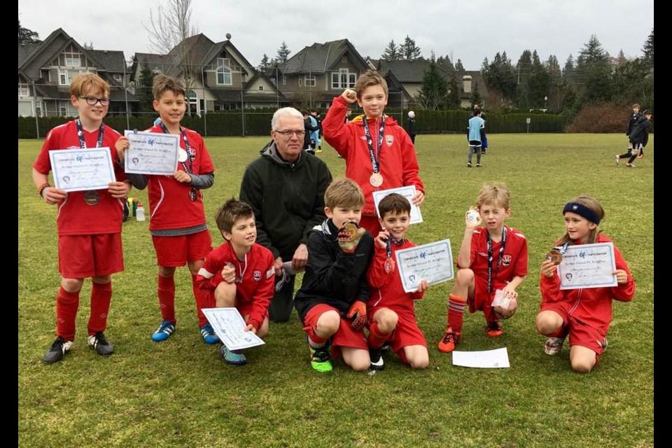 Some members of the Bowen Island FC Under-10 team at the Surrey Mayor Cup. From left, Ryland Bentall, Chris Oban, Leo Szabo, Seth Whyte, Arthur Szabo, Jonah Haigh-Turner, Ewan Roden-Buchanan and Sam Florin.