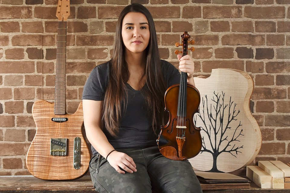 Vancouver luthier Meredith Coloma has built guitars and other instruments for musicians around the world.