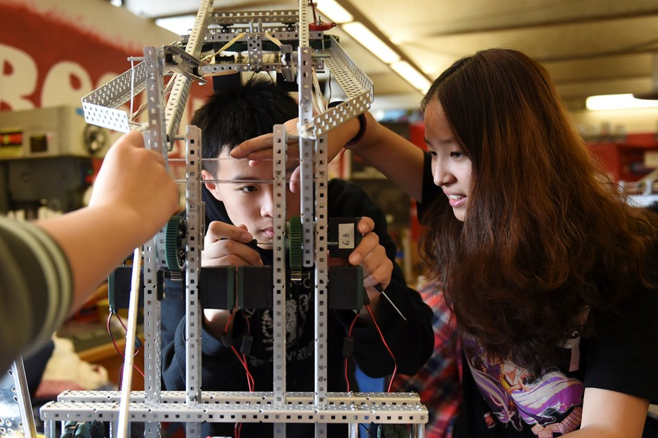 Xing Hao Li and Zoe Tsai are among 22 Gladstone secondary students headed to Kentucky next week to compete in an international robot-building battle. Photo Dan Toulgoet