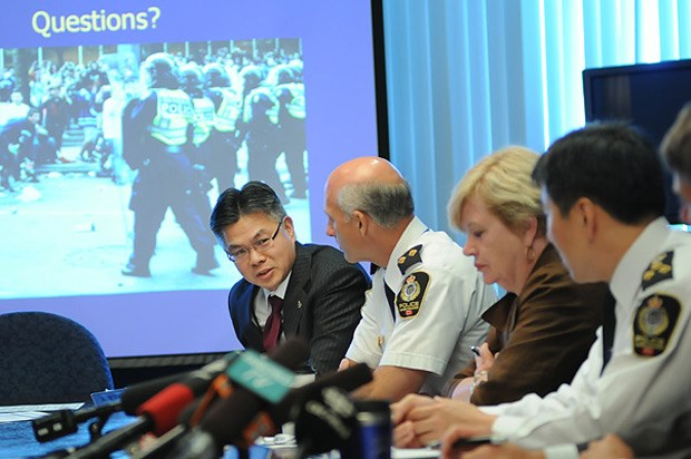Police Board member Glenn Wong (left) speaks at a special police board meeting Tuesday to discuss the VPD's internal review of the Stanley Cup riot.