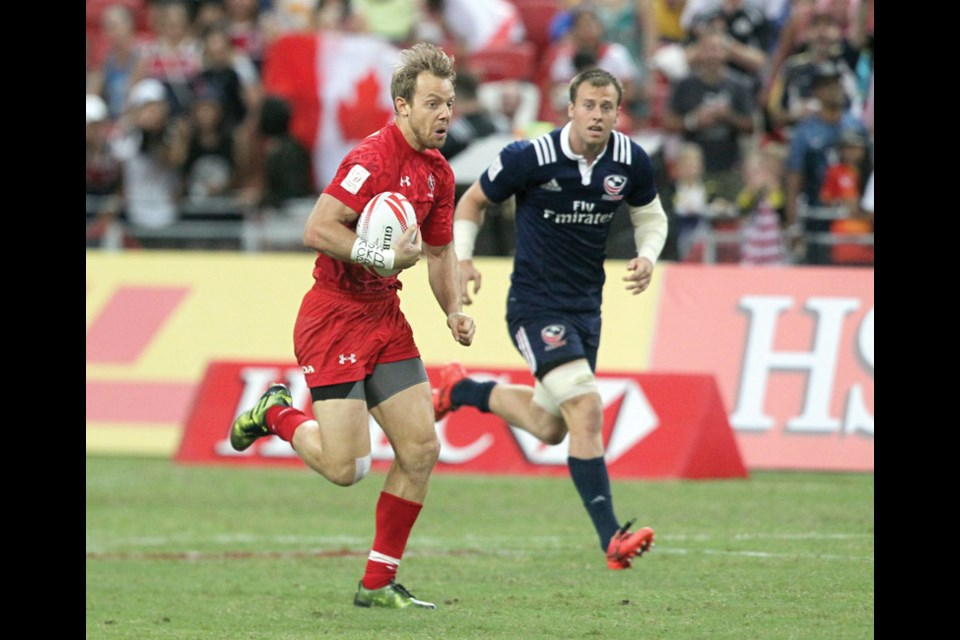 West Vancouver's Harry Jones heads for the end zone during Canada's 26-19 win over the United States en route to the team's first ever World Rugby Sevens Series title Sunday in Singapore. photo Martin Seras Lima