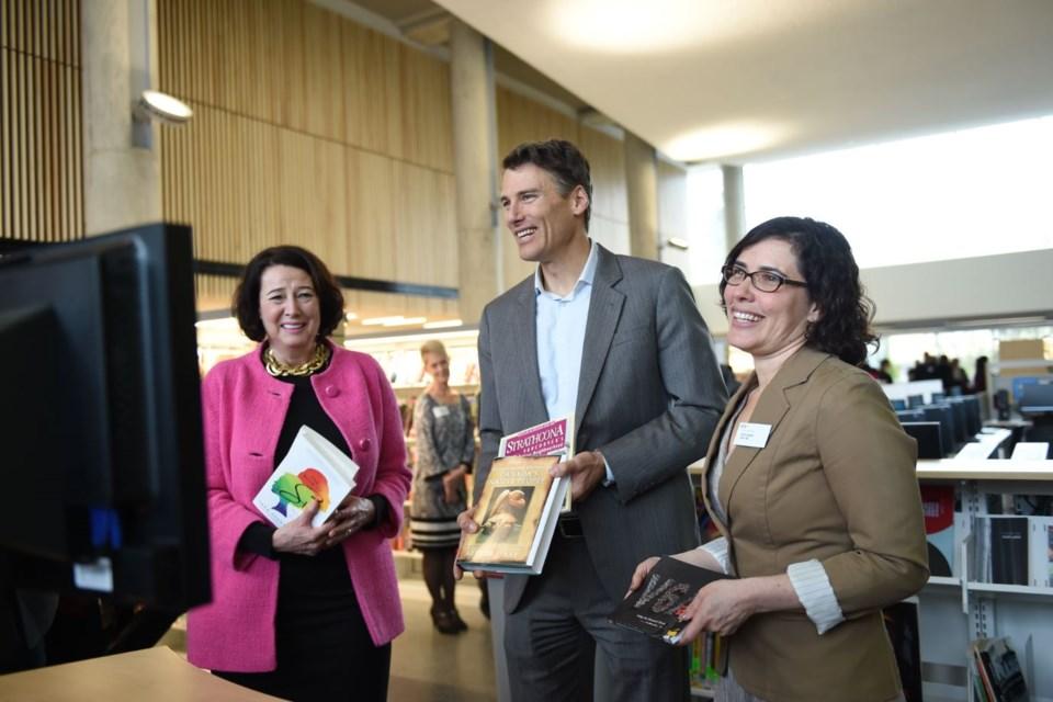 Janet Austin, CEO of Metro Vancouver YWCA, Mayor Gregor Robertson and Vancouver Public Library board