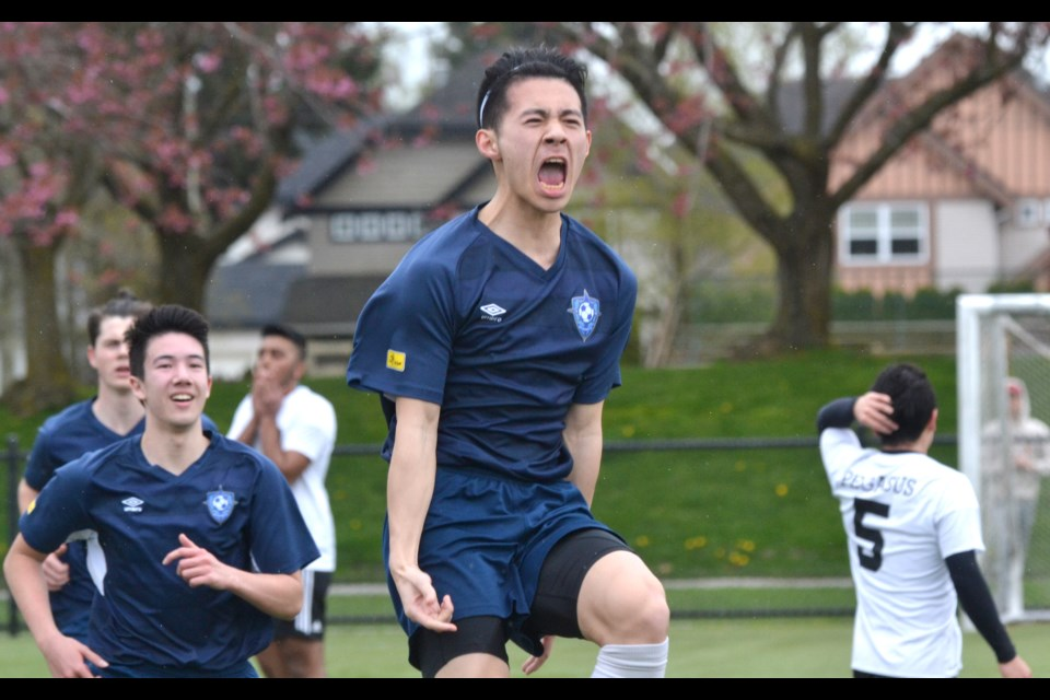 """Richmond FC United's Sean Minato celebrates his first half goal from a corner kick which proved to be the game winner in his team's 4-1 victory over Surrey FC Pegasus in U18 Coastal """"A"""" Cup semi-final action at Hugh Boyd Park."""
