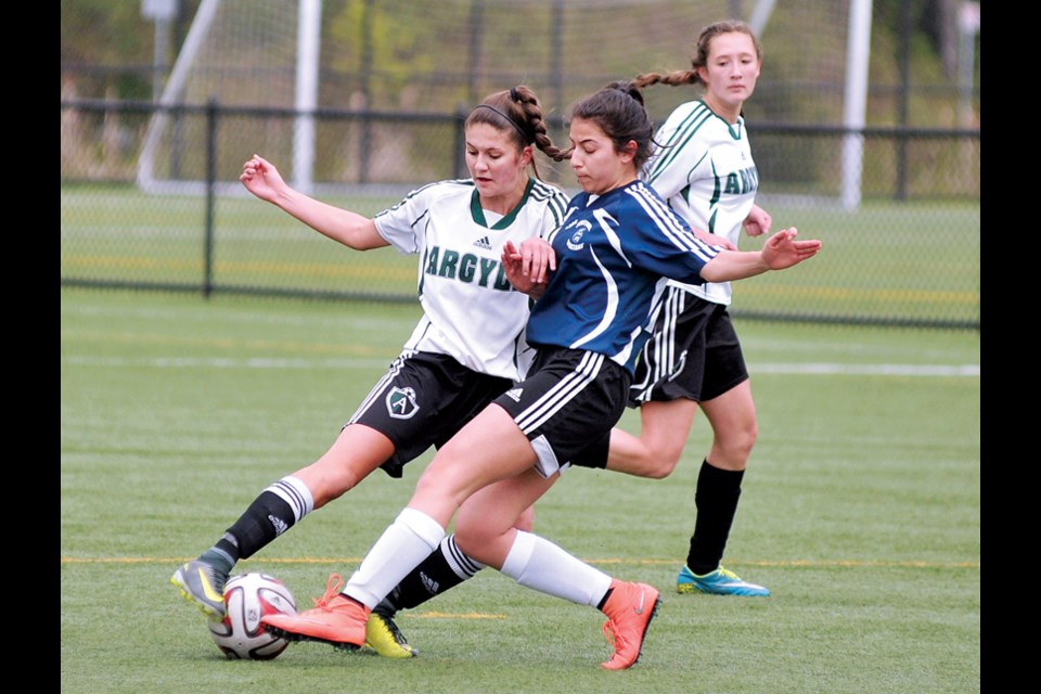 Argyle's Lauren Parr and Sentinel's Tara Abolfathi battle for the ball while Sydney Hills provides support during a 4-1 for Argyle in North Shore senior girls AAA action April 19 at Ambleside Park. photo Paul McGrath, North Shore News