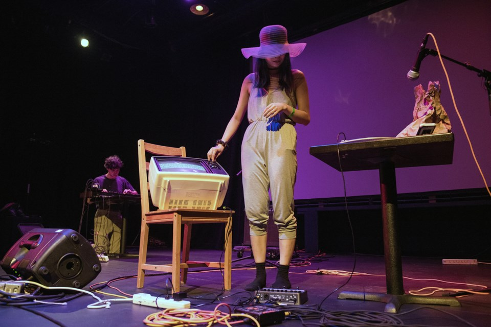 Artist Alanna Ho on Granville Island's Revue Stage during her 15-minute Game of Drones segment. Photo Rebecca Blissett