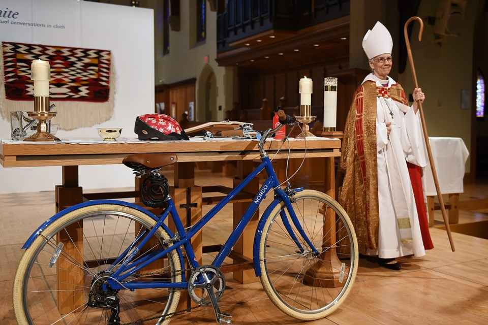 """Christ Church Cathedral held a """"bike blessing"""" Monday afternoon where worshippers and non-worshippers could get their bicycles, Compass cards and shoes blessed with holy water. Photo Dan Toulgoet"""