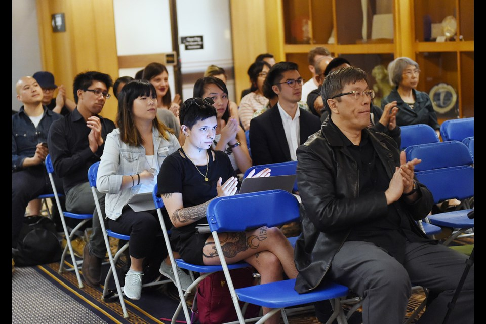 Residents wait to speak Monday at one of four public hearing sessions held at city hall on a 12-storey residential development planned for property at Keefer and Columbia streets in Chinatown. Photo Dan Toulgoet