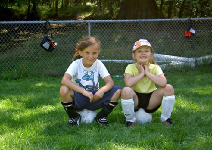 Matilda Shapland and Emily Carlington at the beginning of their soccer careers. Both of them have been recognized for their abilities by the West Vancouver Soccer Club and both are now playing on the same Adult Co-Ed teams as their dads.