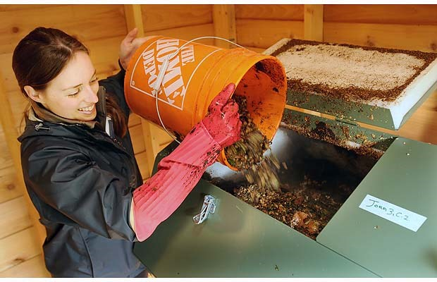 Charlotte Fesnoux of the Strathcona Green Zone Resource Park adds ground up food waste to the composter. The hub wants to compost an estimated 180 kilograms of food waste and food soiled paper products daily.