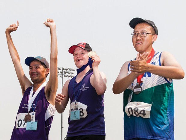Delta Special Olympics athlete Kurtis Reid (centre) had a weekend to remember at the Special Olympics Summer Games in Kamloops July 6 to 9 as he earned three gold medals in the 100m run/sprint, shot put and the standing long jump.