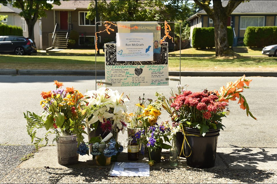A makeshift memorial celebrating Ron McGrath's life has been set up outside the Choices Market on 16th Avenue. Photo Dan Toulgoet