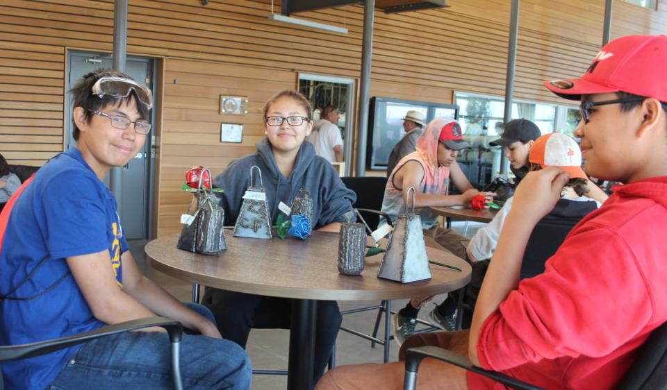 Trey, Ciara, and Konner talk shop.
