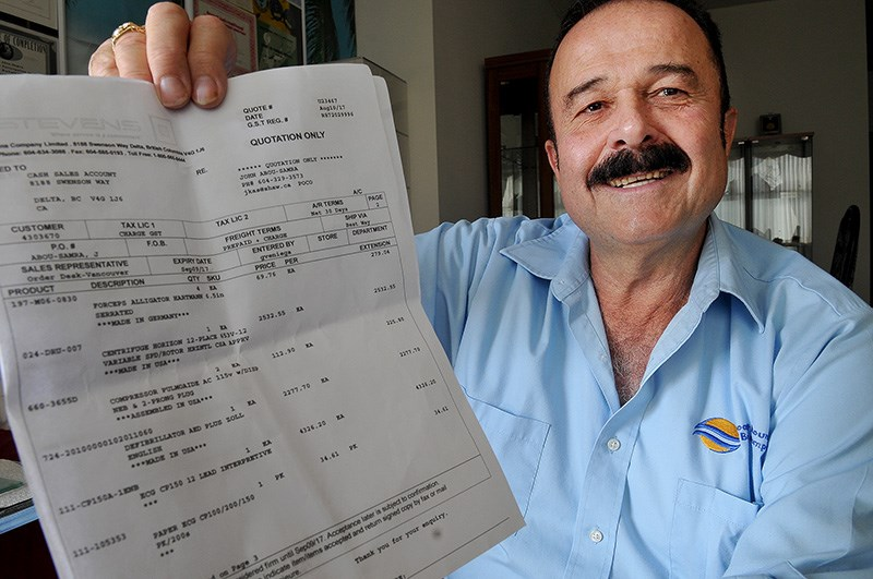 MARIO BARTEL/THE TRI-CITY NEWSJohn Abou-Samra, a Port Coquitlam bus driver, is donating a three-page shopping list of medical supplies to the hospital in Coron, Philippines that treated him after he had an accident while on holiday in June.
