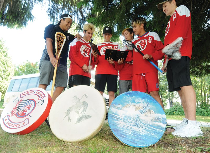 Head coach James Manalo reunites with North Shore Indians Intermediate B lacrosse players Sean George, Brodie Jacobs, Nick Baker, Andrew Joseph and Justin Wheatley following a season that started in tragedy and ended with surprising success. photo Mike Wakefield, North Shore News