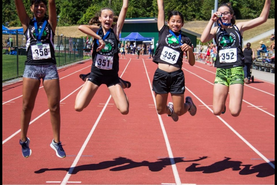 The Royal City Track and Field Club's medley relay, in girls 13 division, celebrate their silver medal.