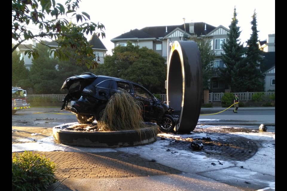 A car jumped the curb at Terra Nova's shopping plaza and crashed into a public art display, momentarily creating a ring of fire Sunday morning (Aug.27, 2017).