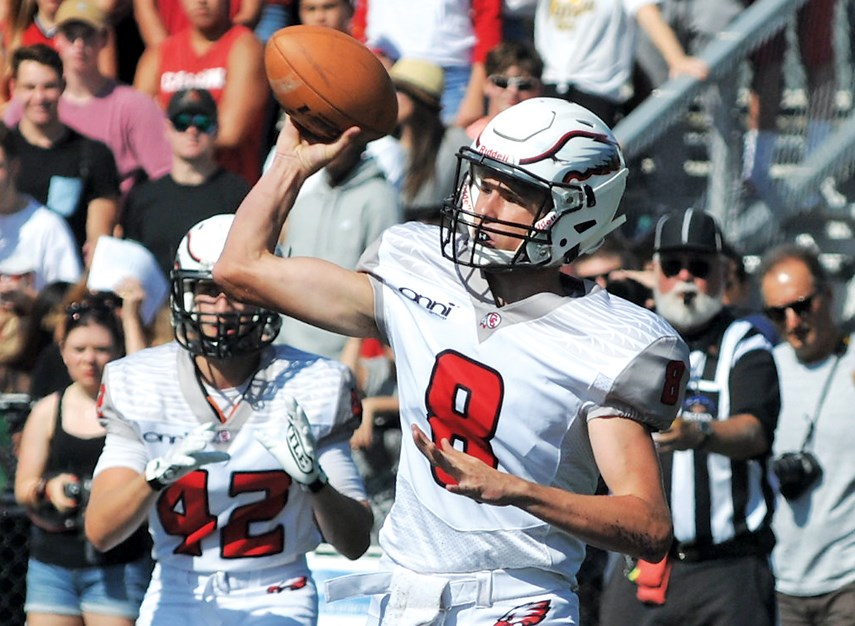 Carson Graham quarterback Charlie McMillan fires a pass during Buchanan Bowl 31 played Saturday at Carson. The Eagles trailed early but scored 41 points in the second half on their way to a 61-21 win over Handsworth. photo Paul McGrath, North Shore News