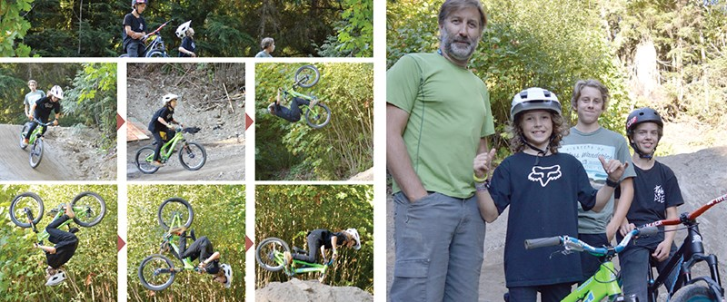Above, Jackson Goldstone pulls off a backflip at one of the newly-completed jumps in the bike park. In the right picture, some of the volunteers who've pitched in to create the course. Ron Goldstone is at the far left with his son Jackson beside him riding a neon green bike. Ben Thompson is to the far right.