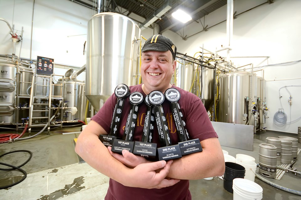 Ben Coli, owner of Dageraad Brewing, shows off the awards his brewery won at the annual beer awards last month. The Burnaby-based brewery took home five trophies, including three gold ones.