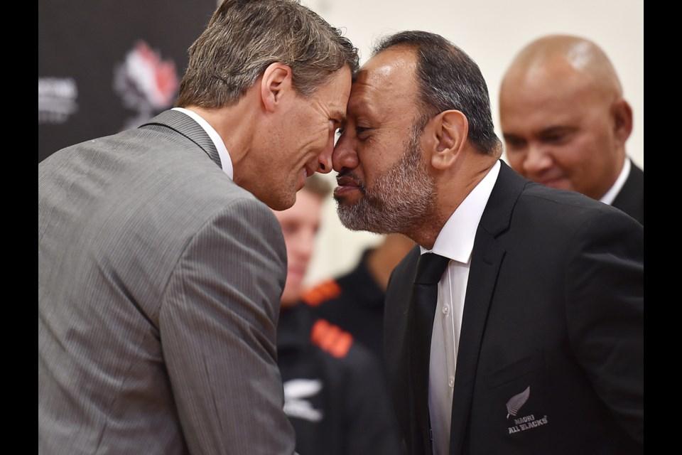 Mayor Gregor Robertson participates in ceremonial welcome greeting with Maori All Blacks board member Bernard Te Paa at Britannia secondary school. Photo Dan Toulgoet
