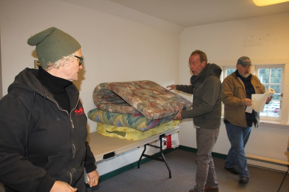 Karen Munroe, Norm Edwards and Marc Baur setting up Bowen's Emergency Shelter above the library. The entrance of the shelter is on the Cardena Rd. side of the library, beside the door to the Children's section. The rules are: no drugs or alcohol on site. Pets are welcome.