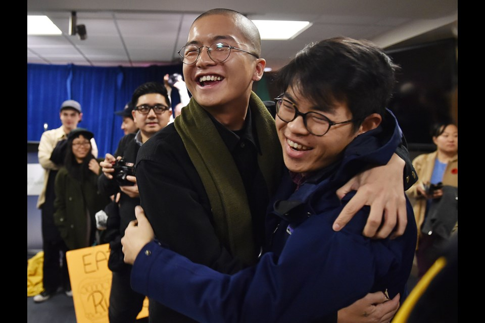 Vincent Tao and Nathanel Lowe celebrate the development permit board's 2-1 decision Monday to reject Beedie's condo proposal for Chinatown. Photo Dan Toulgoet
