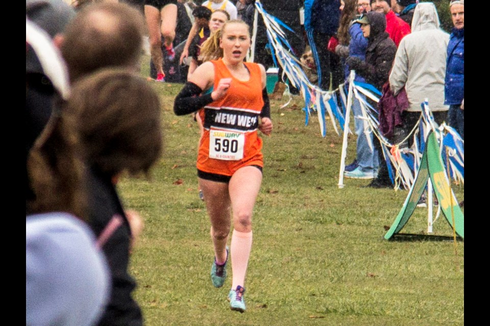 New Westminster's Grace Fetherstonhaugh strides to the finish line at the B.C. High School cross country championships in Vancouver last week. The Royal City Track and Field club member finished second in senior girls.