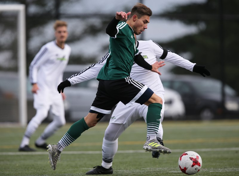 Douglas College's Race Williams drives past an Algonquin Thunder rival during opening round action at last week's Canadian Colleges Athletic Association national men's soccer championship in Nanaimo.
