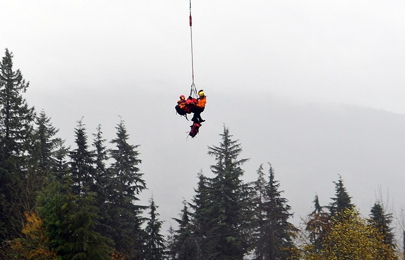 Coquitlam Search and Rescue volunteers, aided by Talon Helicopters, conducted a long-line rescue to ferry Annette Poitras out of the bush of the Coquitlam watershed Wednesday after she and the three dogs she was walking were missing for two days.