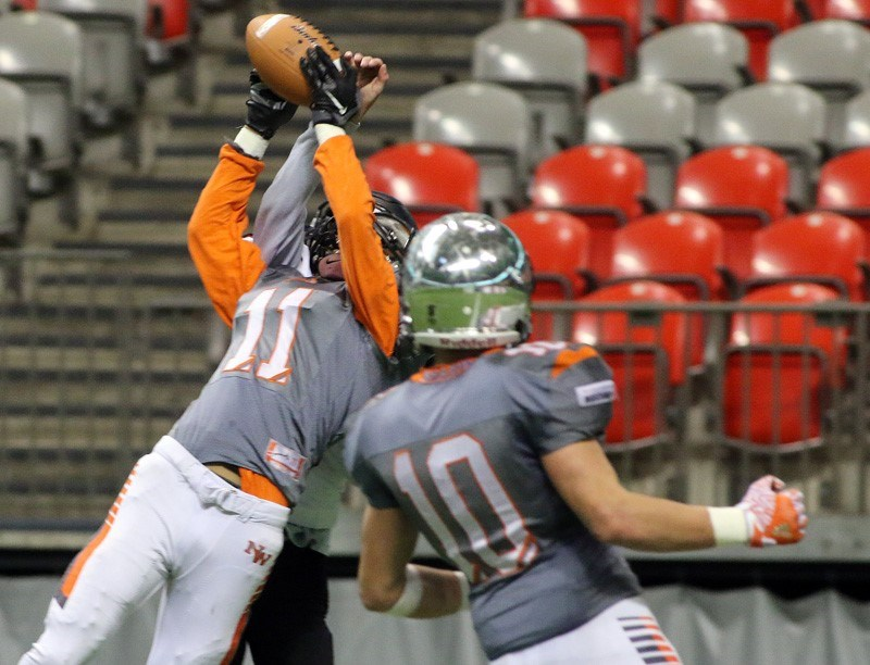 New Westminster's Severio Asaba extends in front of an opponent to catch the crucial last-second touchdown, which led to the Hyacks' two-point convert and first B.C. Subway Bowl senior football title Saturday at B.C. Place.
