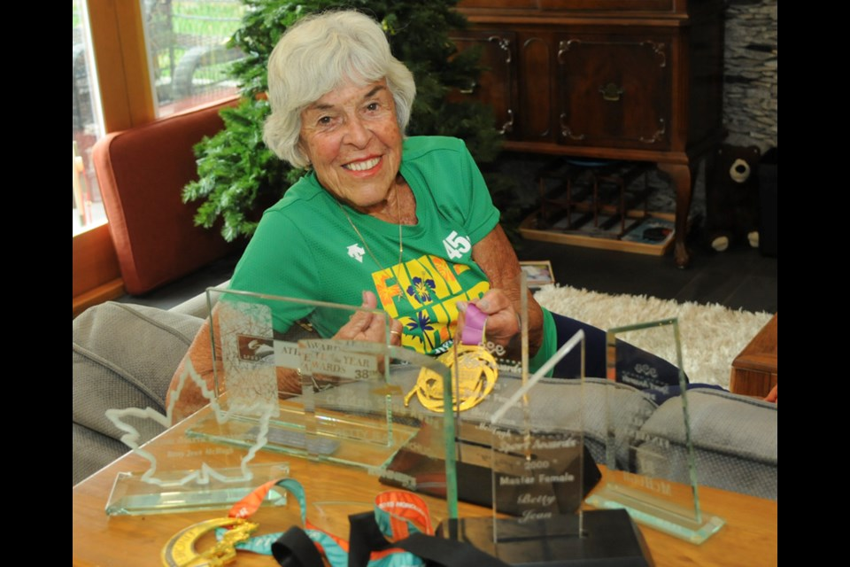 North Vancouver's Betty Jean McHugh shows off some of her hardware, including her newest medal from the Dec. 10 Honolulu Marathon. McHugh smashed the age-group marathon world record for 90-year-olds by two hours. photo Mike Wakefield, North Shore News