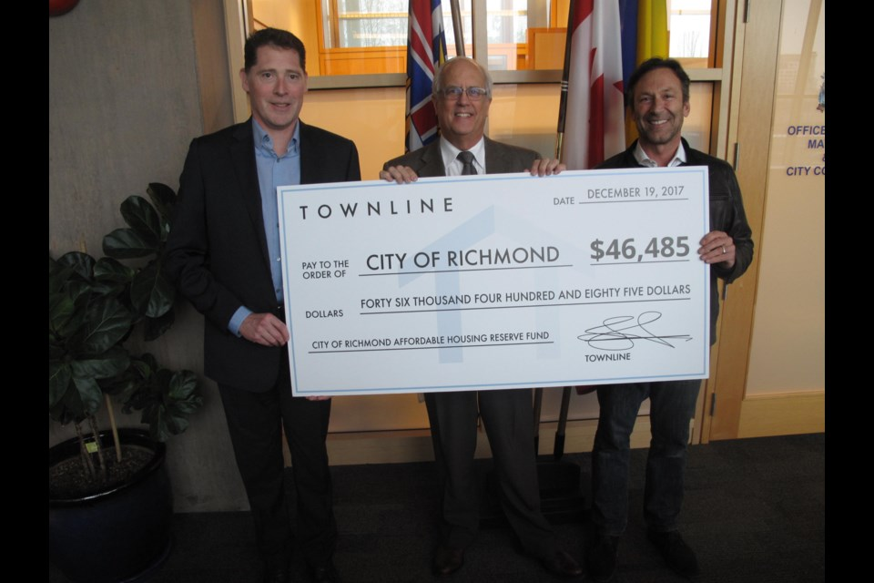 Townline Homes presented Mayor Malcolm Brodie with a cheque for over $46,000 for the City of Richmond's affordable housing reserve. The money was donated from assignment fees from Calla at the Gardens.