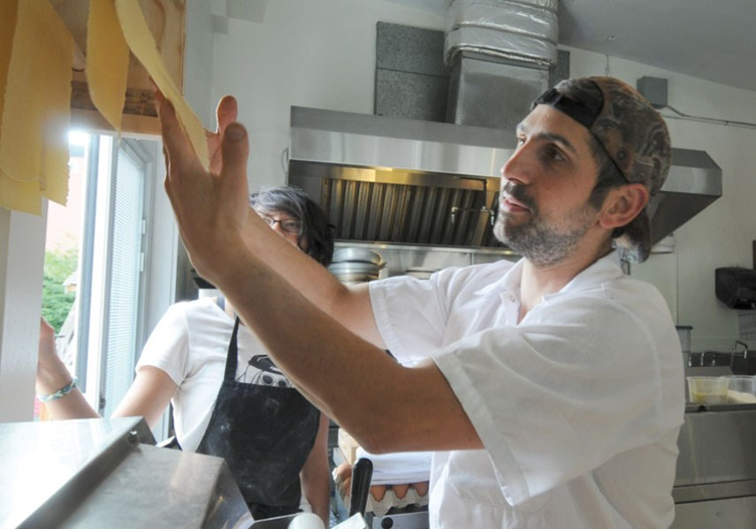 Executive chef Steeve Raye hangs a fresh sheet of pasta up to dry at Orto Artisan Pasta.