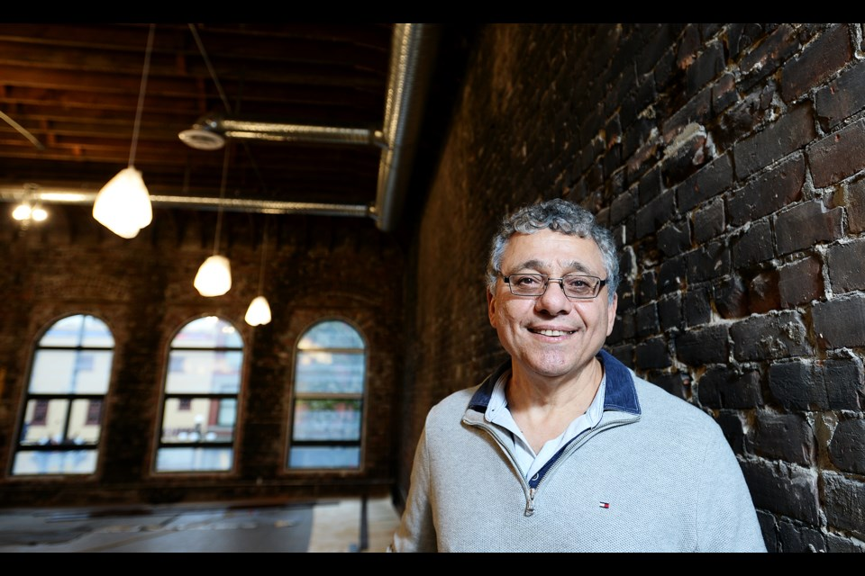 A labour of love: David Sarraf is thrilled with that the restoration of his building at 659 Columbia St. has revealed the building's original arched windows and brick walls. Some of the red bricks show black from a fire in the building in 1968 – something he plans to preserve as its part of the 120-year-old building's history.