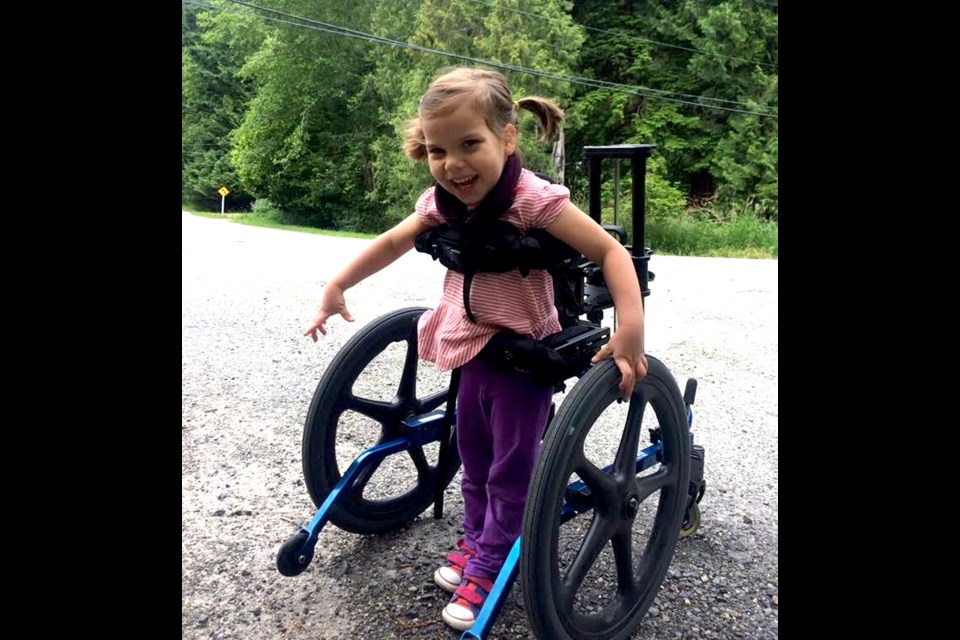 Five year-old Maya Arreaga walks with a walker and enjoys scooting around on her run-trike.